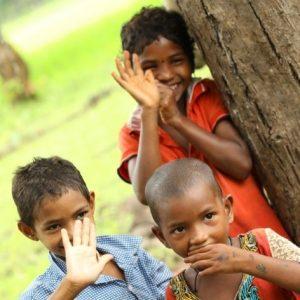 Tribals Children greeting Welltech Foundation Members